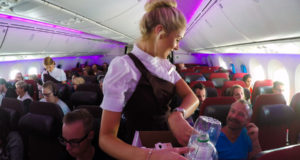 Virgin Atlantic, Ryanair, oil, fuel, cost, weight, plane, aircraft, cut, costs, British Airways, American Airlines, glass, trolley, magazine, paper, makeup, trousers, pants, uniform, lipstick, rules, Qatar Airways, sexist, man, female, woman, wear
